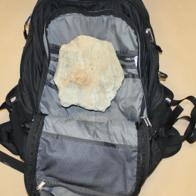 backpack and rock